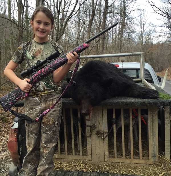 Trinity with her first bear kill. She's been  bear hunting with her father since she was four years old. She was so proud.
