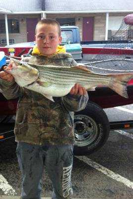 Cayden Keeler of Ripley with a huge striper fish! Great job!