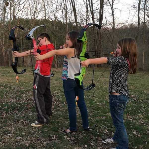 BTB Member Carlee shows some beginners how to shoot a bow.