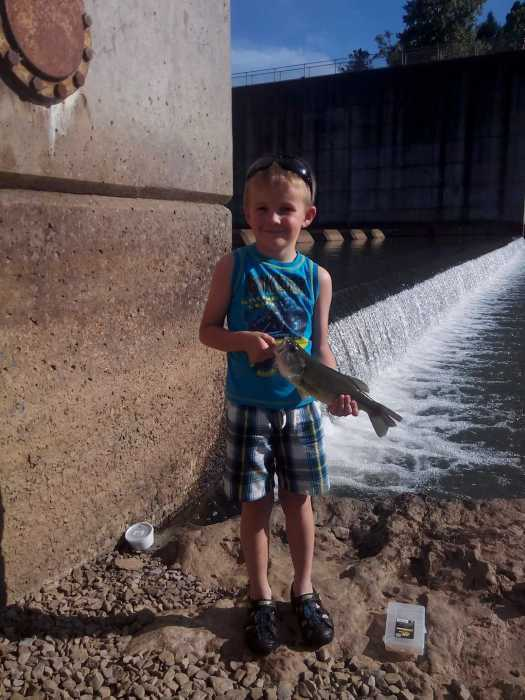 Six-year-old Kyrian caught a large mouth bass at Burnsville Dam.