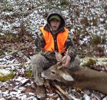 Fourteen-year-old BJ with his six-point buck he killed in Braxton County.