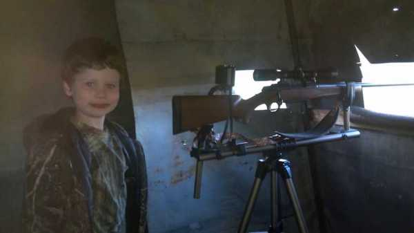 Gavin, 3 years old, set up in a deer blind with his Dad.
