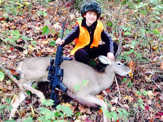 Austin, 10, with his first deer, taken with a .223 Smith Wesson MP Sport