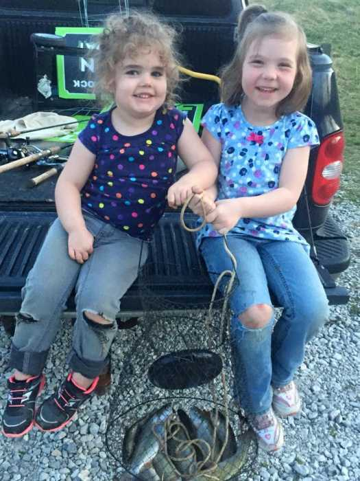 This is Jessalyn, age 3, and her sister, Lexie, age 5. They caught their daily limit of trout at Miller's Fork Pond in Wayne County, West Virginia