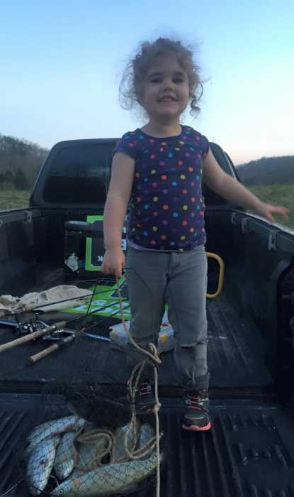 This is Jessalyn, age 3. Her and her sister caught their daily limit of trout at Miller's Fork Pond in Wayne County, West Virginia. Date March 25