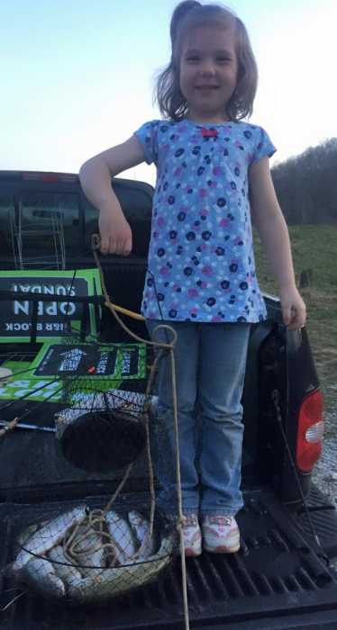 This is Lexie, age 5. She and her sister caught their daily limit of trout at Miller's Fork Pond in Wayne County, West Virginia. Date March 25